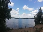 Участок с домом на берегу озера